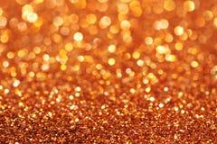 El oro y las luces suaves amarillas y anaranjadas resumen el fondo Foto de archivo libre de regalías