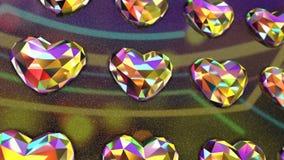 El oscilar en forma de corazón colorido muy vibrante de la pared de los diamantes