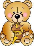 El oso come la miel Foto de archivo libre de regalías