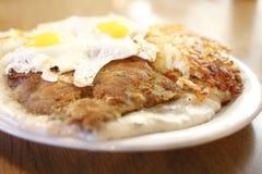 El país frió el filete y los huevos Foto de archivo libre de regalías