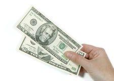 El pagar en dólares Imagen de archivo libre de regalías