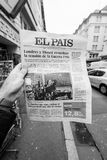 El Pais about dead of Stephen Hawking. PARIS, FRANCE - MAR 15, 2018: Male hand holding Spanish El Pais newspaper with portrait of Stephen Hawking the English royalty free stock images