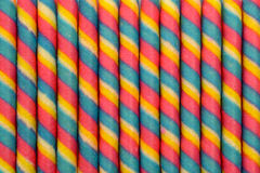 El palillo colorido del rollo de la oblea pattren el fondo Fotografía de archivo libre de regalías