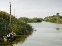 El Palmar. Typical view of La Albufera of Valencia (Spain) with one of the old fishing boats used since years ago Royalty Free Stock Images