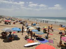 El Palmar beach in Andalusia, Spain. El Palmar beach in the province of Cádiz, Andalusia, south of Spain. It`s summer and the beach is full of tourists enjoying Royalty Free Stock Photo