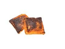 El pan quemado de la tostada aisló el backround blanco con la trayectoria de recortes Fotos de archivo