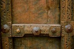 El panel de madera antiguo de la puerta Fotografía de archivo libre de regalías