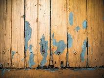 El panel de madera del viejo grunge pintado anaranjado Foto de archivo libre de regalías