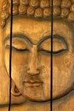 El panel de madera tallado de la cara Foto de archivo libre de regalías