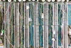 El panel del cableado del teléfono en la pared para las telecomunicaciones Foto de archivo libre de regalías