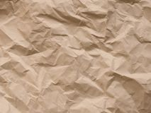 El papel arrugado, enciende el fondo texturizado foto de archivo libre de regalías