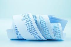 El papel de la facturación rueda en tono azul Foto de archivo libre de regalías