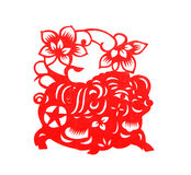 El papel rojo cortó símbolos de un zodiaco del cerdo Fotos de archivo libres de regalías