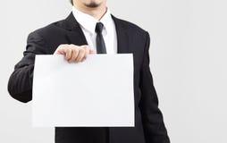 El papel temporario de la demostración del hombre de negocios para algo comunica Fotografía de archivo