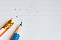 El papel y dos lápices Imágenes de archivo libres de regalías
