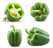 El paprika verde determinado cortó por la mitad, entero fotos de archivo