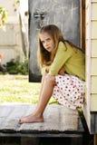 El parecer que se sienta de la muchacha enojado Imagen de archivo libre de regalías