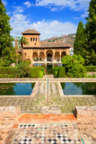 El Partal of the Alhambra de Granada. El Partal, an amazing garden with ponds behind which stands the Tower of the Ladies Stock Images