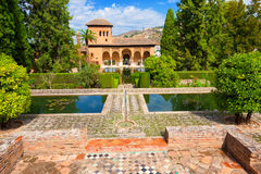 El Partal of the Alhambra de Granada. El Partal, an amazing garden with ponds behind which stands the Tower of the Ladies Royalty Free Stock Photography