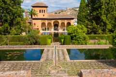 El Partal of the Alhambra de Granada. El Partal, an amazing garden with ponds behind which stands the Tower of the Ladies Royalty Free Stock Image