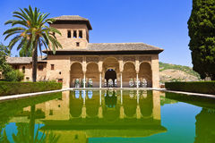 El Partal of the Alhambra de Granada. El Partal. A large central pond faces the arched portico behind which stands the Tower of the Ladies Stock Photos