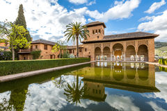 El Partal Alhambra de Granada. El Partal. A large central pond faces the arched portico behind which stands the Tower of the Ladies, inside the Alhambra of Stock Images