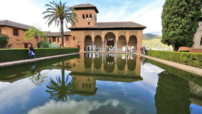 El Partal Alhambra Granada. Granada, Andalusia, Spain - circa April 2016: El Partal in Granada Alhambra, Unesco Site in Spain. A large central pond faces the stock footage