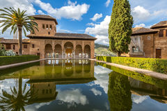 El Partal Alhambra Granada. El Partal in Alhambra of Granada, Unesco Heritage Site, Andalusia, Spain. A large central pond faces the arched portico which stands Royalty Free Stock Photo