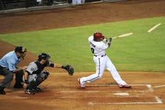 El partir del bate de béisbol Imagen de archivo libre de regalías