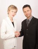 El partnering de la mujer del hombre de negocios Imagen de archivo