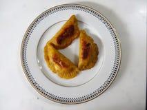 El pastel tradicional del platain de la comida de Honduras llenó de la fruta o de la carne 3 Fotos de archivo