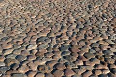 El pavimento de guijarros. Imagen de archivo libre de regalías