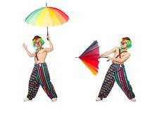 El payaso con el paraguas aislado en blanco foto de archivo libre de regalías