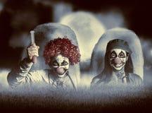 El payaso malvado del zombi cuida el levantamiento de los muertos Fotos de archivo libres de regalías