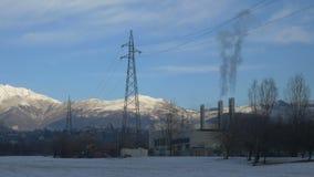 El PDA tiró en las chimeneas de una fábrica de la materia textil, Biella, Italia