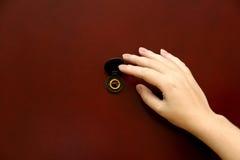 El peephole con la mano Imagen de archivo libre de regalías