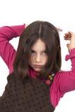 El peinarse hermoso de la niña Imagen de archivo libre de regalías