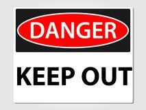 El peligro guarda hacia fuera la muestra en un fondo gris Imagen de archivo