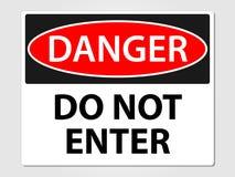 El peligro no incorpora la muestra en un fondo gris Imágenes de archivo libres de regalías