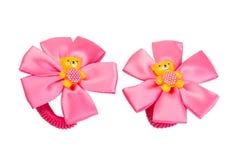 El pelo de dos niños rosados del arco Fotos de archivo