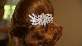 El pelo hermoso de la novia hace antes de una boda fotografía de archivo libre de regalías