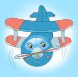 El pequeño aeroplano feliz vuela en el cielo Imagen de archivo libre de regalías