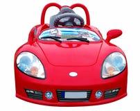 El pequeño coche rojo. Juguete del cuarto de niños. Imagen de archivo libre de regalías