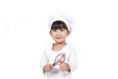 El pequeño cocinar feliz lindo del bebé foto de archivo
