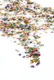 El pequeño color numera confeti en blanco Imágenes de archivo libres de regalías