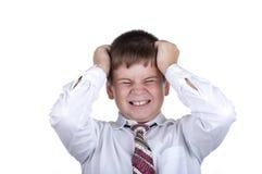 El pequeño muchacho descontento Foto de archivo libre de regalías