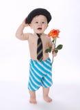 El pequeño muchacho divertido con subió en blanco Imagenes de archivo
