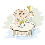 El pequeño niño come en la tabla Imagen de archivo libre de regalías