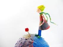 El pequeño príncipe y el suyo subieron Imagen de archivo libre de regalías
