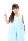 El pequeño señalar asiático de la muchacha Fotografía de archivo libre de regalías